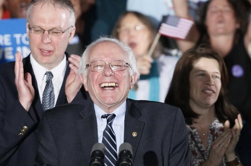 Democratic U.S. presidential candidate Bernie Sanders smiles after winning at his 2016 New Hampshire presidential primary night rally in Concord, New Hampshire February 9, 2016. Photo: Reuters/Rick Wilking