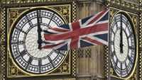 A British Union Jack flag is seen flying near a face of the clocktower at the Houses of Parliament in London, Britain, February 1, 2016. Photo: Reuters/Toby Melville