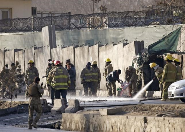 Afghan fire-fighters and members of security forces clean the site of a suicide attack in Kabul, Afghanistan February 1, 2016. Photo: Reuters/Omar Sobhani