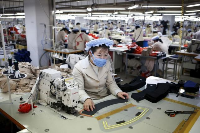 A North Korean employee works in a factory of a South Korean company at the Joint Industrial Park in Kaesong industrial zone, a few miles inside North Korea from the heavily fortified border in this December 19, 2013 file photo. Photo: Reuters/Kim Hong-Ji/Files