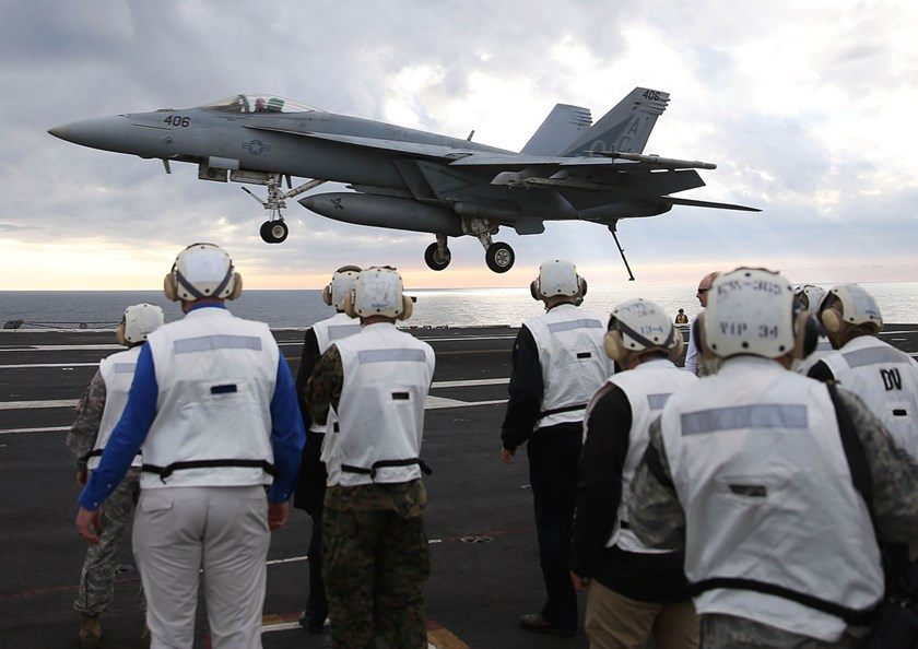 """A F18 Super Hornet prepares to land on the deck of the USS Eisenhower. The Pentagon in a report released in May said China's rapid military modernization """"has the potential to reduce core U.S. military technological advantages."""" Photo: Mark Wilson/Getty Images"""