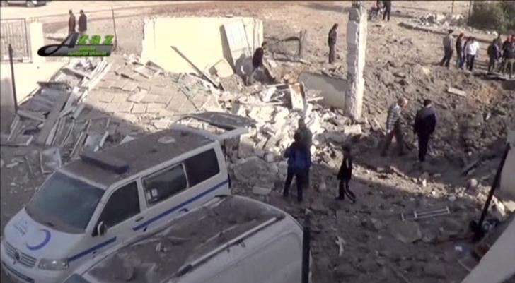 People gather near what is said to be a hospital damaged by missile attacks in Azaz, Aleppo, Syria, February 15, 2016 in this still image taken from a video on a social media website. Photo: Reuters/Social Media Website via Reuters TV