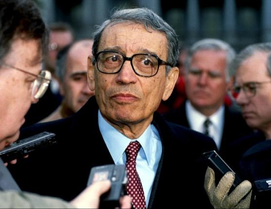 U.N. Secretary-General Boutros Boutros-Ghali is surrounded by members of the media as he leaves the White House after meeting U.S. President Bill Clinton, in this February 23, 1993 file picture. Photo: Reuters/Stringer/Files