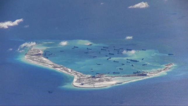 Chinese dredging vessels are purportedly seen in the waters around Mischief Reef in the disputed Spratly Islands in the South China Sea, May 21, 2015. Photo: Reuters/U.S. Navy/Handout via Reuters