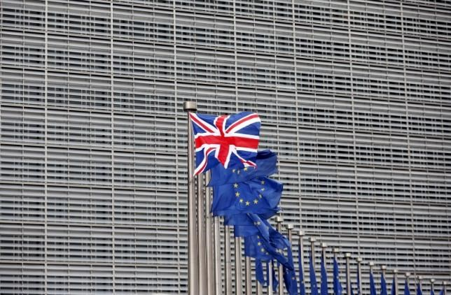 A Union Jack flag flutters next to European Union flags ahead of a visit from Britain's Prime Minister David Cameron at the EU Commission headquarters in Brussels, Belgium, in this January 29, 2016 file photo. Photo: Reuters/Francois Lenoir/Files