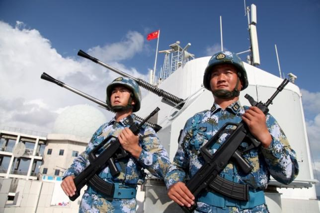 Soldiers of China's People's Liberation Army (PLA) Navy stand guard in the Spratly Islands, known in China as the Nansha Islands, February 10, 2016. Photo: Reuters/Stringer