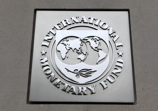 The International Monetary Fund (IMF) logo is seen at the IMF headquarters building during the 2013 Spring Meeting of the International Monetary Fund and World Bank in Washington, April 18, 2013. Photo: Reuters/Yuri Gripas