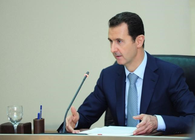Syria's President Bashar al-Assad heads a meeting of his new cabinet in Damascus August 31, 2014 in this picture released by Syria's national news agency SANA. Photo: Reuters/SANA/Handout via Reuters