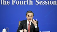 China's Foreign Minister Wang Yi gestures as he speaks during a news conference on the sidelines of the National People's Congress, in Beijing, China, March 8, 2016. Photo: Reuters/China Daily