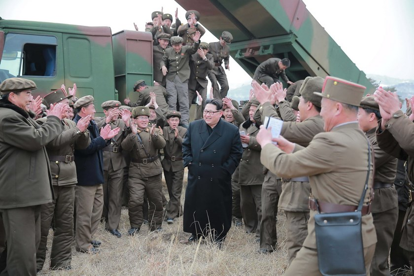 North Korean leader Kim Jong Un (C) smiles as he guides a test fire of a new multiple launch rocket system in this undated photo released by North Korea's Korean Central News Agency (KCNA) in Pyongyang March 4, 2016. REUTERS/KCNA