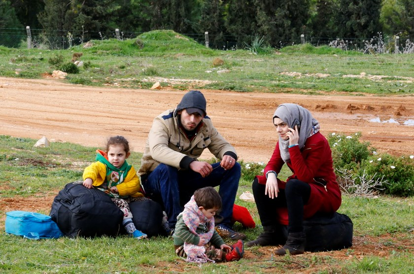 Syrian refugees wait on a roadside after Turkish police prevented them from sailing off to the Greek island of Farmakonisi by dinghies, near a beach in the western Turkish coastal town of Didim, Turkey, March 9, 2016. Photo: Reuters/Umit Bektas