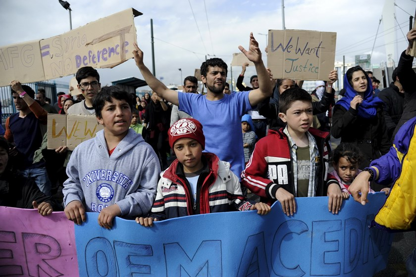 Stranded Afghan migrants take part in a protest march to demand for the opening of European borders at the port of Piraeus, near Athens, Greece, March 8, 2016. Photo: Reuters/Michalis Karagianni