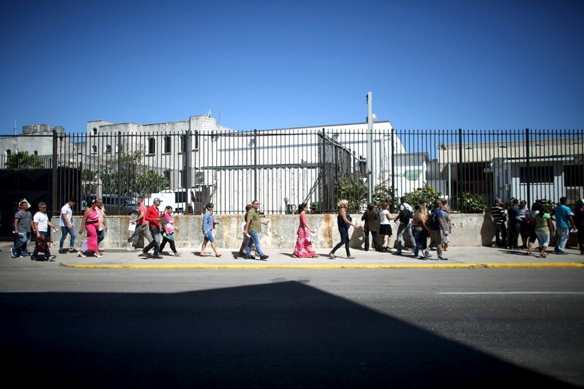 People wait in line to enter the U.S. Embassy in Havana, March 9, 2016. Photo: Reuters/Alexandre Meneghini