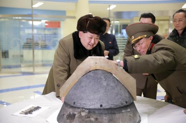 North Korean leader Kim Jong Un looks at a rocket warhead tip after a simulated test of atmospheric re-entry of a ballistic missile, at an unidentified location in this undated photo released by North Korea's Korean Central News Agency in Pyongyang on March 15, 2016. Photo: Reuters/KCNA