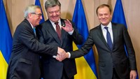 Ukraine vows swift end to political crisis, wins EU offer of visa-free travel