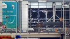 Broken windows seen at the scene of explosions at Zaventem airport near Brussels, Belgium, March 22, 2016. Photo: Reuters/Francois Lenoir