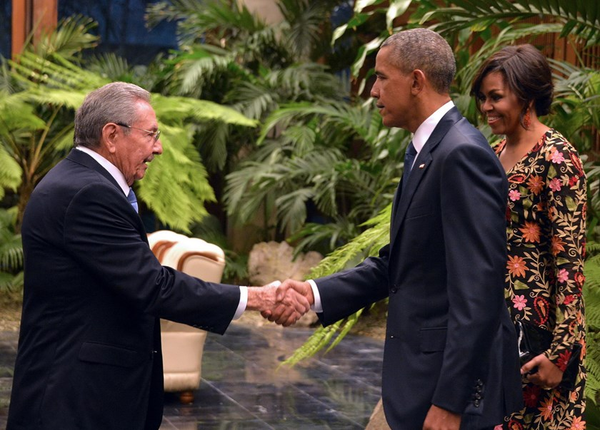 "Cuban President Raul Castro (L) shakes hands with US President Barack Obama next to US First Lady Michelle Obama (R), ahead of the state dinner at the Revolution Palace in Havana on March 21, 2016. Obama and Castro vowed Monday in Havana to set aside their differences in pursuit of what the US president called a ""new day"" for the long bitterly divided neighbors. Photo: AFP/Adalberto Roque"
