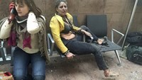Injured people are seen at the scene of explosions at Zaventem airport near Brussels, Belgium, March 22, 2016. Reuters/Ketevan Kardava/Courtesy of 1tv.ge/Handout via Reuters