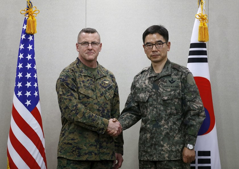 South Korean defense ministry's Director General Major General Jang Kyung-soo shakes hands with U.S. Forces Korea's Major General Robert Hedelund (L) during their working-level talk to discuss the potential deployment of a THAAD missile defense system at the Defense Ministry in Seoul, South Korea, March 4, 2016. REUTERS/Kim Hong-Ji