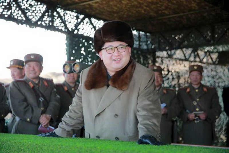 North Korean leader Kim Jong Un watches landing and anti-landing exercises being carried out by the Korean People's Army (KPA) at an unknown location, in this undated photo released by North Korea's Korean Central News Agency (KCNA) in Pyongyang on March 20, 2016. Photo: Reuters/KCNA