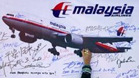 Malaysia says should search for more possible MH370 debris in South African coast