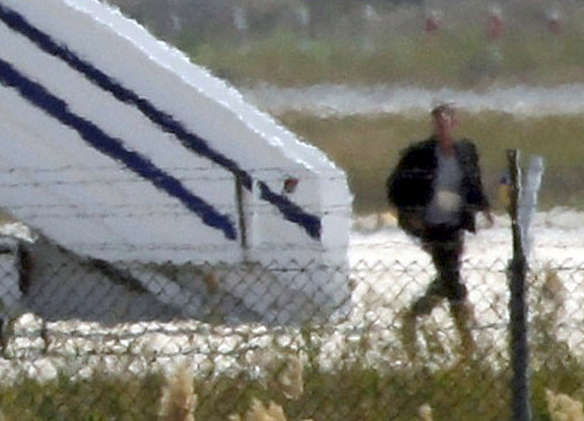 A man thought to be the hijacker leaves the hijacked Egyptair Airbus A320 at Larnaca Airport in Larnaca, Cyprus, March 29, 2016. Photo: Reuters/Yiannis Kourtoglou