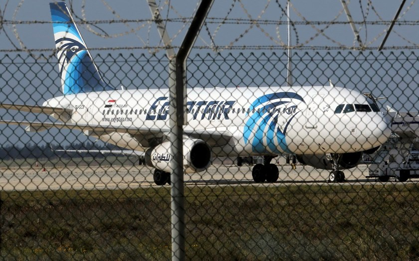 A hijacked Egyptair Airbus A320 airbus stands on the runway at Larnaca Airport in Larnaca, Cyprus , March 29, 2016. Photo: Reuters/Yiannis Kourtoglou