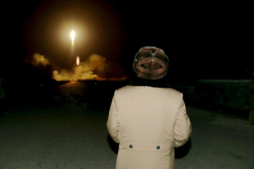 North Korean leader Kim Jong Un watches the ballistic rocket launch drill of the Strategic Force of the Korean People's Army (KPA) at an unknown location, in this undated photo released by North Korea's Korean Central News Agency (KCNA) in Pyongyang on March 11, 2016. Photo: REUTERS/KCNA