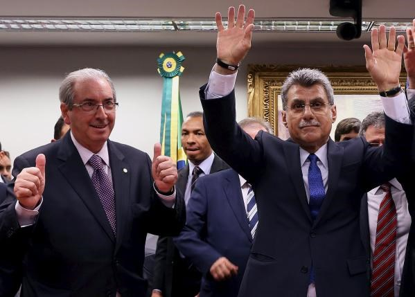 Senator Romero Juca (R) and Lower House Speaker Eduardo Cunha of the Brazilian Democratic Movement Party (PMDB) celebrate after announcing that they are withdrawing their support of President Dilma Rousseff's ruling coalition during their National Executive Meeting on March 29, 2016. Photo: Reuters/Adriano Machado