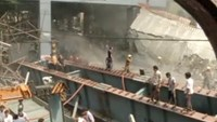 People are seen standing on the debris of a a flyover which collapsed, in Kolkata, India, in this still image taken from video March 31, 2016. Photo: REUTERS/ANI via Reuters TV