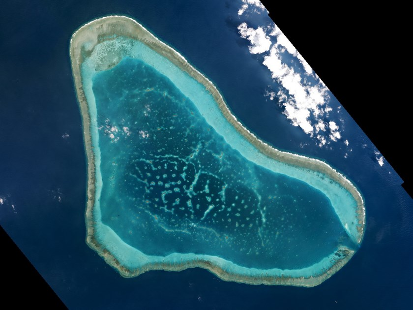 Boats at Scarborough Shoal in the South China Sea are shown in this handout photo provided by Planet Labs, and captured on March 12, 2016. Photo: Reuters/Planet Labs/Handout via Reuters