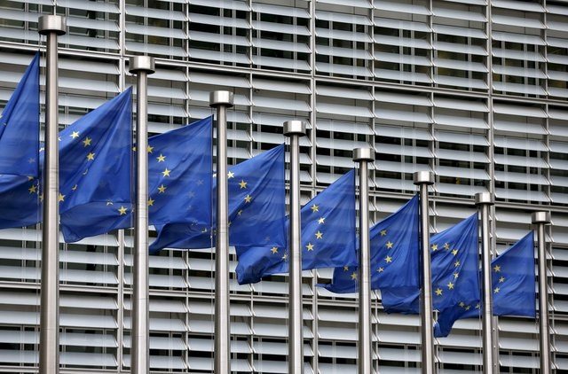 European Union flags flutter outside the EU Commission headquarters in Brussels, Belgium, in this file picture taken October 28, 2015. Photo: Reuters/Francois Lenoir/Files