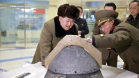 North Korean leader Kim Jong Un looks at a rocket warhead tip after a simulated test of atmospheric re-entry of a ballistic missile, at an unidentified location in this undated file photo released by North Korea's Korean Central News Agency (KCNA) in Pyongyang on March 15, 2016. Photo: Reuters/KCNA/Files