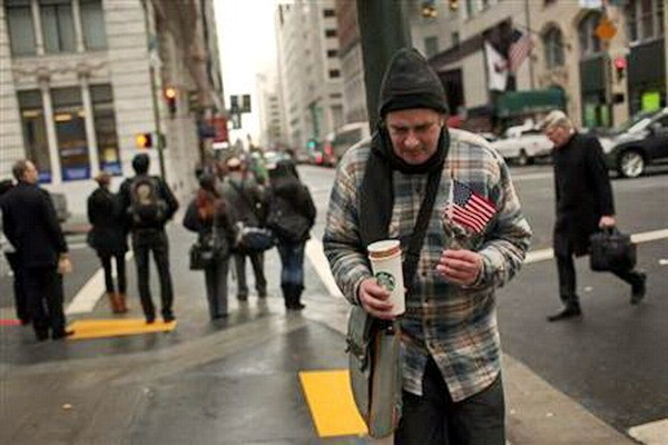 A homeless man begs for money in the Financial District in San Francisco, California March 28, 2012. Photo: Reuters/Robert Galbraith