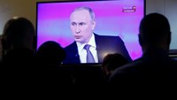Putin says shares Russians' pain over economic hardship