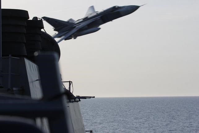 An U.S. Navy picture shows what appears to be a Russian Sukhoi SU-24 attack aircraft making a very low pass close to the U.S. guided missile destroyer USS Donald Cook in the Baltic Sea in this picture taken April 12, 2016 and released April 13, 2016. Photo: Reuters/US Navy/Handout via Reuters