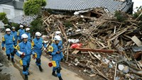 Police officers check a collapsed house after an earthquake in Mashiki town, Kumamoto prefecture, southern Japan, in this photo taken by Kyodo April 17, 2016. Photo: Reuters/Kyodo