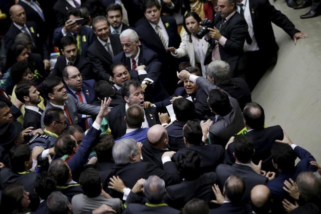 Congressmen, who support or oppose the impeachment, argue during a session to review the request for Brazilian President Dilma Rousseff's impeachment, at the Chamber of Deputies in Brasilia. Photo: Reuters/Ueslei Marcelino