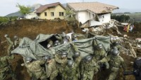Japan Ground Self-Defense Force soldiers carry a person found under landslide rubble following an earthquake in Minamiaso town, Kumamoto prefecture, southern Japan, in this photo taken by Kyodo April 19, 2016. Photo credit: Kyodo/via Reuters