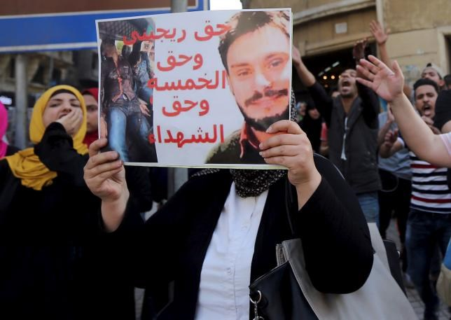 An Egyptian activist holds a poster calling for justice to be done in the case of the recently murdered Italian student Giulio Regeni during a demonstration protesting the government's decision to transfer two Red Sea islands to Saudi Arabia. Photo: REUTERS/MOHAMED ABD EL GHANY
