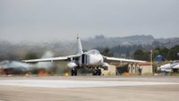 A Russian Sukhoi Su-24 front-line bomber is seen on a runway shortly before taking off, part of the withdrawal of Russian troops from Syria, at Hmeymim airbase, Syria, March 16, 2016. REUTERS/Russian Ministry of Defence/Vadim Grishankin/Handout via Reuters