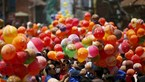 People hold balloons before releasing them during an event organized to commemorate the victims of last year's earthquakes in Kathmandu, Nepal, April 23, 2016. Photo: Reuters/Navesh Chitrakar