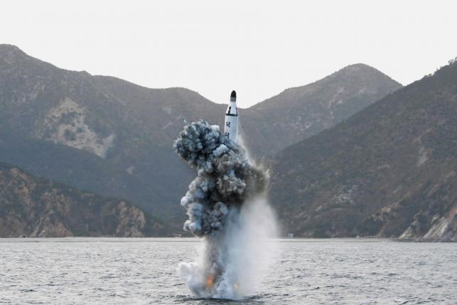 North Korean leader Kim Jong Un guides on the spot the underwater test-fire of strategic submarine ballistic missile in this undated photo released by North Korea's Korean Central News Agency (KCNA) in Pyongyang on April 24, 2016. KCNA/via REUTERS