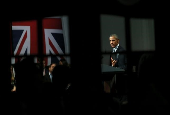 U.S. President Barrack Obama is reflected in a mirror as he takes part in a Town Hall meeting at Lindley Hall in London, Britain, April 23, 2016. Photo: Reuters/Stefan Wermuth