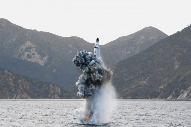 North Korean leader Kim Jong Un guides on the spot the underwater test-fire of strategic submarine ballistic missile in this undated photo released by North Korea's Korean Central News Agency (KCNA) in Pyongyang on April 24, 2016. Photo: KCNA/via Reuters