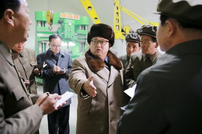 North Korean leader Kim Jong Un (C) speaks during a visit to the Sinhung Machine Plant in this undated photo released by North Korea's Korean Central News Agency (KCNA) in Pyongyang April 1, 2016.REUTERS/KCNA