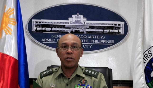 Armed Forces of the Philippines (AFP) Chief Public Affairs Office and army colonel Noel Detoyato gives a press statement regarding on the execution of a Canadian hostage, John Ridsdel by Abu Sayyaf militants in the southern Philippines, inside the military headquarters in Quezon city, metro Manila, Philippines April 26, 2016. REUTERS/Romeo Ranoco