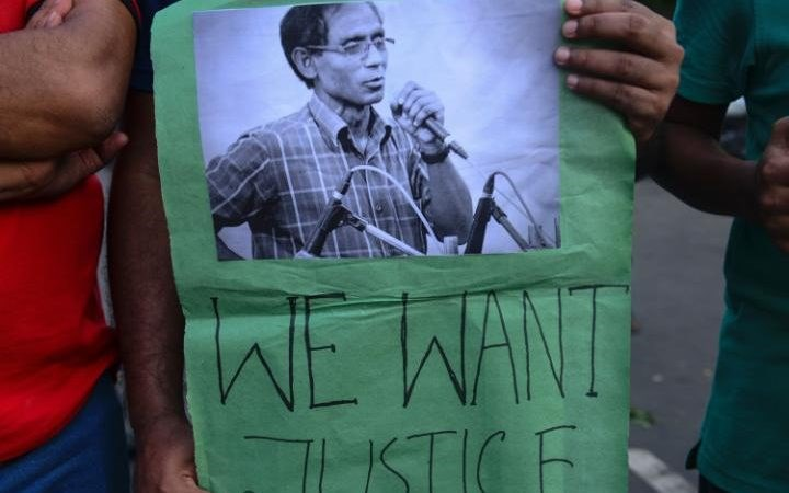 A banner commemorating the earlier murder of a university professor in Bangladesh. Radical Islamists have carried out a series of religious killings in the country, targeting minorities and secular Muslims. Photo: AFP