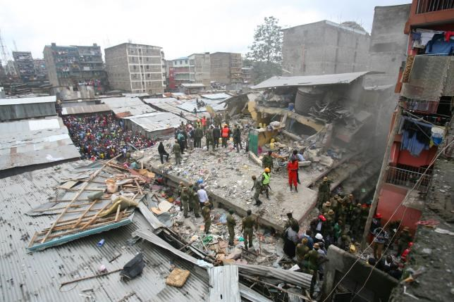 A general view shows rescue workers searching for residents feared trapped in the rubble of a six-story building that collapsed after days of heavy rain, in Nairobi, Kenya April 30, 2016. Photo: Reuters/Gregory Olando