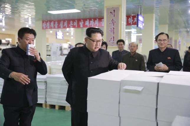 North Korean leader Kim Jong Un gives field guidance during his visit to the newly built Mindulle Notebook Factory in this undated photo released by North Korea's Korean Central News Agency (KCNA) in Pyongyang on April 19, 2016. KCNA/ via Reuters